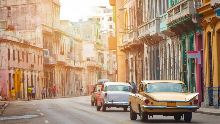 downtown-havana-cuba-with-vintage-cars.jpg